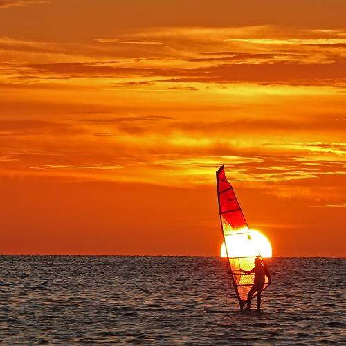 Seeing Sunset Through My Sail